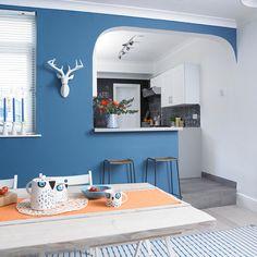 Blue kitchen-diner with innovative breakfast bar