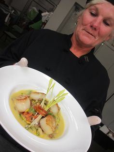 Kathy presenting Chef Brunski's plate up of our seared scallop entree atop seasonal succotash. By Hamby Catering & Events