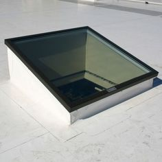 For flat or very low slope roofs, skylights are mounted on a curb, like this unit atop a large commercial building. The minimum roof slope for a deck-mounted skylight is typically 15 degrees, or about Pergola With Roof, Patio Roof, Diy Pergola, Pergola Plans, Pergola Ideas, Roof Ideas, Casas Country, Types Of Roofing Materials, Roofing Felt