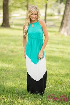 The colorblock style on this maxi is fabulous! Featuring teal, white, and black, this dress has some gorgeous colors, while the halter style straps and the cute keyhole cutouts on the front and back add some trendy flair.