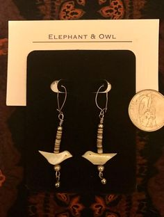 Two Little Birds shell, wood, and metal earrings.  $20.00, US shipping included.  International shipping is calculated and can take up to 21 days to arrive.  Paypal is preferred.  Please message me for other payment options. Thank you! Little Birds, 21 Days, Shell, Elephant, Owl, Messages, Facebook, Metal, Earrings