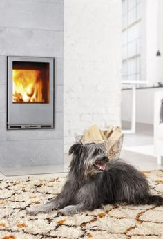 Tulikivi Hiisi 2 soapstone fireplace. It can be heated either with wood or pellets. Nice, small and sleek looking fireplace that brings comfortable warmth to a room.