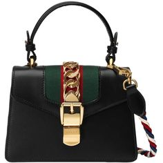 Shop the Sylvie leather mini bag by Gucci. The Sylvie mini bag in a top  handle shape with nylon Web embedded under the fabric and decorated with a  gold ... 44edf99cad