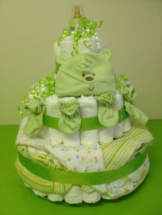 "Large Green Gerber diaper cake from shergifts.com  $125.00 3 Tier diaper cake. First tier, 7 size 1, Second tier 19 size 1, Third tier, 56 size 2 Pampers diapers. Includes a baby shower game ""Never say Baby"" (6 pc Baby pins),1 baby bottle. BPA free, 1 Gerber bib, 2 Gerber onesie,2 reciving blanket,1 sm bottle shampoo,1 sm bottle baby lotion,1 sm bottle baby body wash,1 sm baby power,1 penaten rash cream and 4 wash cloth.1 Green outfit includes hat pair of mitts and booties,1 hairbrush comb set."