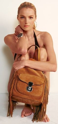 The Drawstring Ricky Bag gets updated for the season with supple suede and luxe fringe.