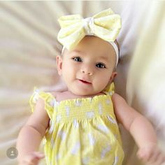 Yellow fabric bow on lace