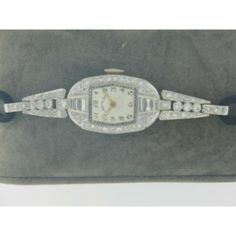 Estate Lady Elgin Platinum With 6 Baguette Cut And 62 Round Diamonds .75 Ctw Estimated On Black Cord Band Short Estate Lady Elgin Platinum And Diamond Watch Long Estate Lady Elgin Platinum With 6 Baguette Cut And 62 Round Diamonds .75 Ctw Estimated On Black Cord Band Tags Elgin