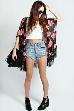 Shop this look on Lookastic: https://lookastic.com/women/looks/kimono-cropped-top-shorts-ankle-boots-crossbody-bag/2683 — Black Floral Kimono — White Cropped Top — Light Blue Denim Shorts — Black Leather Crossbody Bag — Black Cutout Leather Ankle Boots