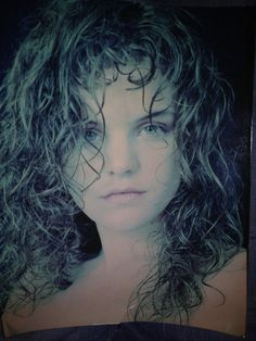 Pauley Perrette - old model pic: 15, blonde, curly haired, serious