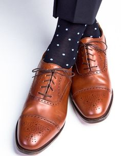 These fine men's dress socks are made with an exceptionally soft mercerized cotton. Expertly knitted at a third-generation North Carolina mill, these fashionable socks are a timeless addition to every Groom Socks, Best Bridal Shoes, Blue Wedding Shoes, Wedding Ties, Ivory Wedding, Polka Dot Socks, Polka Dots, Gentleman Shoes, Navy Blue Suit