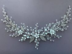 Wedding headpiece Bridal hairpiece Silver leaf vine Crystal hair vine Rhinestone vine Rhinestone wreath Crystals headpiece Wedding hair comb -------------------------- Hello my dear bride! Exclusive sprig with flowers, crystal made from jewelry wire, small leaves made of crystal.