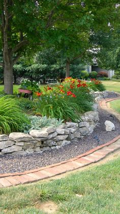 thinking of a small rock wall in the front yard, to frame the flowers in front of the porch
