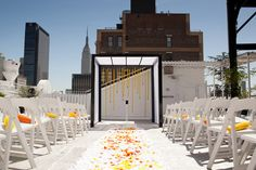 Rooftop wedding ceremony in NYC. Photos by Image Singuliere via JunebugWeddings.com