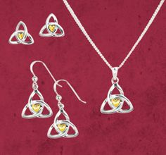 Celtic Valentine - Golden Heart Jewelry:  A gold heart gleams within the balance and harmony of the trinity knot - a tribute to centering power of enduring love.