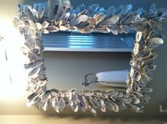 My oyster shell mirror! My 2 boys gathered oyster shells for me at Fish Haul Beach in Hilton Head. It was so much fun to make.