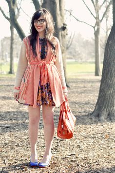 The rich coral, white, purple, and golden hues of this look are just perfect for springtime and I love how the almost bed jacket-inspired cardigan looks so adorable when layered over the floral dress.