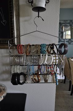 Turn a pant hanger into a bracelet organizer! This is a great idea, can't believe I didn't think of this, use to have one of the these hangers, gone in a garage sale! Bracelet Organizer, Bracelet Holders, Bracelet Display, Jewelry Holder, Bracelet Storage, Necklace Holder, Geek Jewelry, Jewlery, Jewelry Necklaces