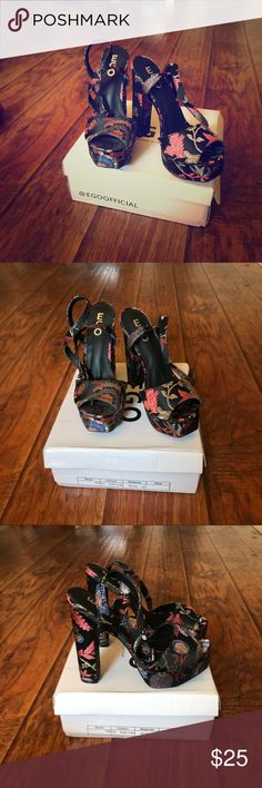 High heels floral platform heel in black floral print/ absolutely new/  Size 5 UK/ 7 US shoes from London, I can't return them because shipping is going to be more expensive that shoes, so, I'm selling them out. They are look amazing Ego Shoes Shoes Heels