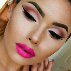 Gorgeously done pink cut crease, with a bold and drastic black liner.