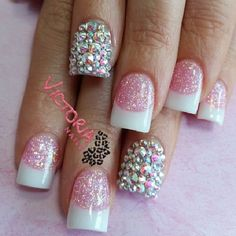 I don't like the silver jeweled nails but I do like the glittered French!
