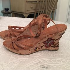"""Bandolino Mary Janes Bandolino Mary Janes with approximately 4"""" wedge heel. Beautiful Beading on the side of both sandals. Also has about a 1/2 platform in the front which makes them more comfortable. Bandolino Shoes Wedges"""