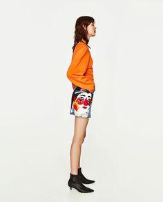 Image 4 of RIPPED DENIM MINI SKIRT WITH JAPANESE DESIGN from Zara