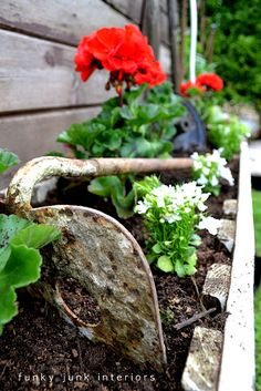 rusty tools = perfect garden accents. love this!!