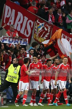 SL Benfica's forward from Mexico Raul Jimenez celebrates with teammates after scoring a goal during the UEFA Champions League Quarter Final: Second Leg match between SL Benfica and FC Bayern Munchen at Estadio da Luz on April 13, 2016 in Lisbon, Portugal.