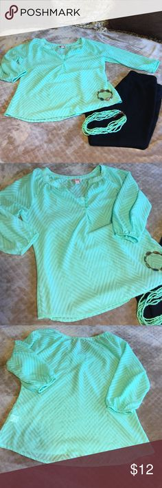2 hr FLASH SALE! Mint Green Candies Blouse Women's or Junior's Size Large Mint Green Blouse w/subtle chevron pattern. V-neck with four buttons. Pretty details. Excellent, Like NEW Condition. Comes from smoke free, pet free and odor free home. I welcome all offers. BUNDLE & SAVE! 2 HOUR FLASH SALE! PRICE REDUCED FROM $10 TO $8 UNTIL 7PM ECT. Candies Tops Blouses