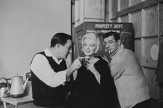 "1960 / Coffee break for Marilyn, Gene Kelly and Yves Montand during the shooting of ""Let's Make Love""."