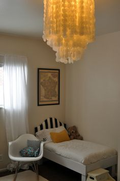 his beach inspired chandelier is actually crafted from wax paper instead of shells!