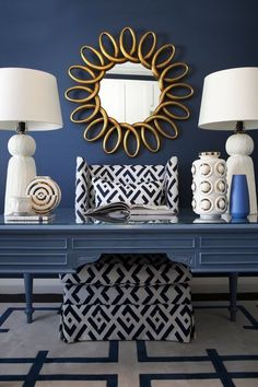 Home decorating ideas - Glamorous Navy blue, white and gold with dark navy accent wall, painted desk, white symmetrical table lamps, gold accent mirror and graphic navy and white patterns on rug and chair | Glamorous Galah - desire to inspire - desiretoinspire.net