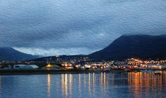Ushuaia ,Argentina - the southern-most city in the world. Only about 1,000 miles from Antarctica, Ushuaia is the jumping-off point for many an expedition. This shot was taken as our ship was pulling away from shore at night. I transformed the image to look like a watercolor painting.