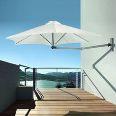 The Paraflex Wallflex Umbrella take the umbrella stand out of the equation by attaching the umbrella to the wall, so it doesn't take up precious deck space. http://www.yliving.com/blog/umbrosa-modern-umbrellas/