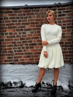 This is a beautiful off-white/ivory colored wool sweater dress from the 1980s made by Compris.   #wool #long #sleeve #white #dress #bubble #skirt #Compris #retro #vintage #fashion #dress #gown #wedding #style #stylist #Exposed #brick #knee #length #1960's #1970's #1980's #1990's #shoulder #pads #boho #hipster #hippie