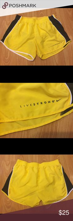 💛 RARE!! Live Strong Yellow & Black Nike Shorts Nike Brand. Live Strong Edition. Black, Yellow & White. Like new, worn once. No cracks, or tears. Size Medium. Attached Lined Panty. 💛 Nike Shorts