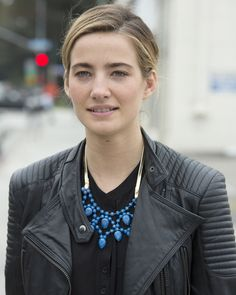 Cobalt blue necklace adds charm to a tough chick look.