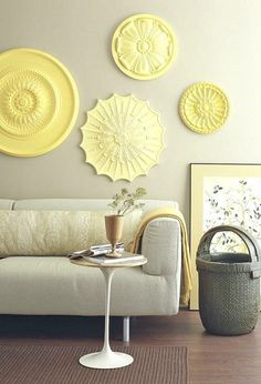 25 DIY Wall Art Ideas - With a little wallpaper and a trip to the builder's supply store, some architecturally interesting results are in full bloom… Like this charming arrangement of painted ceiling rosettes. [from Better Homes and Gardens via  Apartment Therapy]