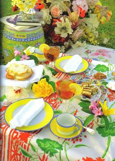 COLORFUL VIBRANT AND SUMMERY TABLE SETTING with- Fresh Hot OR Cold Ice Tea + Bread and Butter (Jam optional) + Yellow, Pink, White, and Red Flowers + Tiramisu and Other Pastries + Yellow/Blue Dishes + Summery White and Orange Table Cloth!