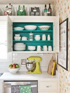 Easy-to-grab bins are great for corralling goodies on the tippy-top shelf.