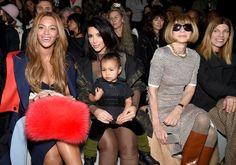 North West in black velvet pants, a vest, and green socks alongside Anna Wintour and Beyoncé.