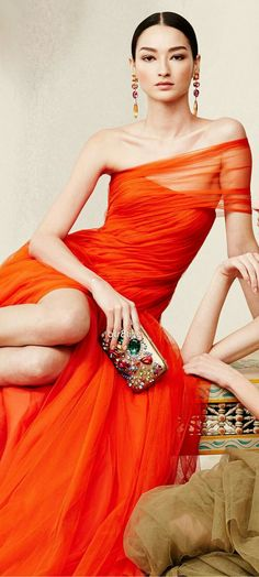Stunning orange gown with beautiful jewels. I love the translucent shoulder detail. x