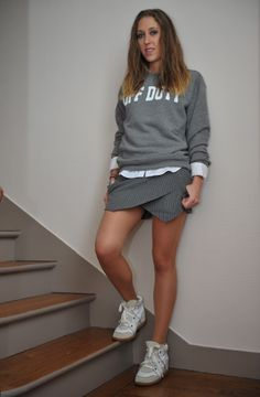 "gray ""Off Duty"" sweater + white blouse + gray and white pinstripe skort + Isabel Marant Leather and suede wedge sneakers"