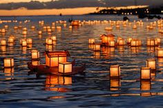 Obon Festival, Japan ~~ Buddhist families release floating lanterns into the water to represent their ancestors' spirits being sent off.
