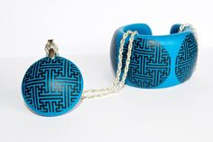 Pendant with matching bracelet featuring Mongolian traditional pattern