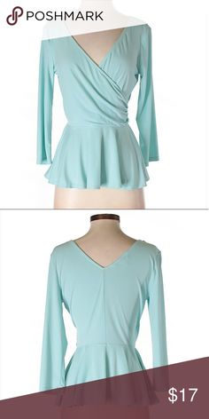 """Sale🌸🌸🌸Surplice peplum top Boston Proper 3/4 Sleeve Top Size S but can also fit Size M  V-Neckline 3/4 Sleeve Light Blue Solid Peplum silhouette Measurements 34"""" Chest, 17"""" Length Materials 95% Polyester, 5% Spandex Boston Proper Tops Blouses"""