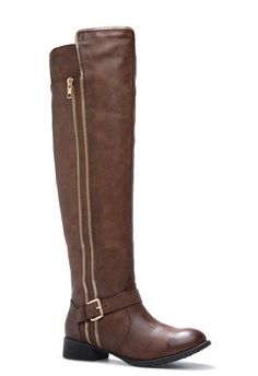 Take the zipper trend to the next level with Jaylen. She throws an of-the-moment touch to a classic over-the-knee boot.