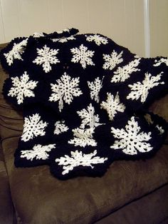 Crochet snowflake throw. I think grey and white would look better. Or maybe an ice blue and silvery white.