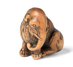 A WOOD NETSUKE OF A BAKU Early 19th century Sold for £ 33,650 (US$ 47,278) inc. premium THE HARRIET SZECHENYI SALE OF JAPANESE ART 8 Nov 2011