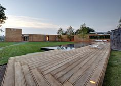 This design for a vacation home in Water Mill, New York, utilizes a boardwalk as an architectural device for weaving together multiple portions of a historic site with new buildings and landscape elements.  A boardwalk extends from the two structures to provide a connection between the two. As the path continues it passes the Geller Studio, now a pool house, and connects to shaded outdoor living spaces. A new central lawn is defined as the boardwalk wraps to extend through the main house.